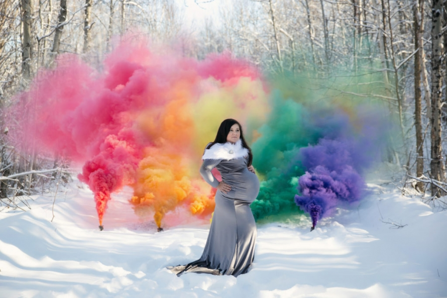 rainbow color smoke bomb outside maternity photo with gray long dress pregnancy photography