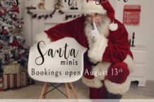 helga himer photography sudbury studio hosting a Santa mini session in November on the photo Santa clause is crouching beside a chair at a Christmas setup